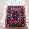 نمونه فرش بافته شده توسط یکی از هنرآموزهای فروشگاه قالی بافی